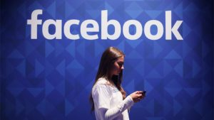 "Fake new inquiry. File photo dated 03/11/15 of a woman using her phone under a Facebook logo, as the social network has told the Government's fake news inquiry it will expand its investigation into whether Russian agents attempted to influence the Brexit vote. Issue date: Wednesday January 17, 2018. In a letter to Damian Collins, chair of the Digital, Culture, Media and Sport (DCMS) Committee, Facebook's head of policy in the UK, Simon Milner, said the social media giant would now search for ""clusters engaged in coordinated activity around the Brexit referendum"" which appear to have originated in Russia. See PA story POLITICS Russia. Photo credit should read: Niall Carson/PA Wire URN:34504208"