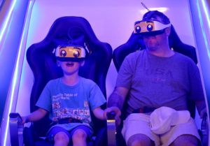 (051318 Somerville, MA) Charlie Talbot,7, and his father Phil participate in a virtual reality attraction at Legoland Discovery Center in Somerville on Sunday,May 13, 2018. Staff Photo by Nancy Lane