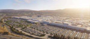 https---blogs-images.forbes.com-sebastianblanco-files-2018-12-tesla-factory-aerial-view-1200x521